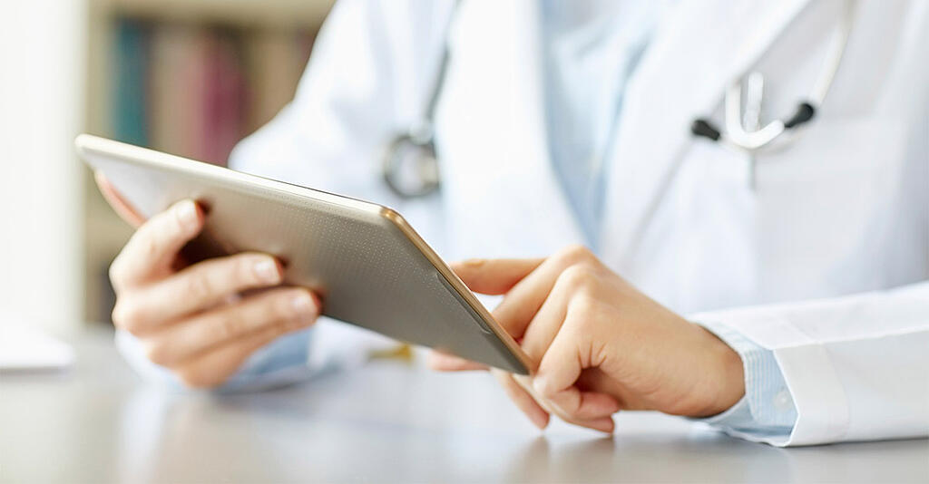 doctor-with-tablet.jpg